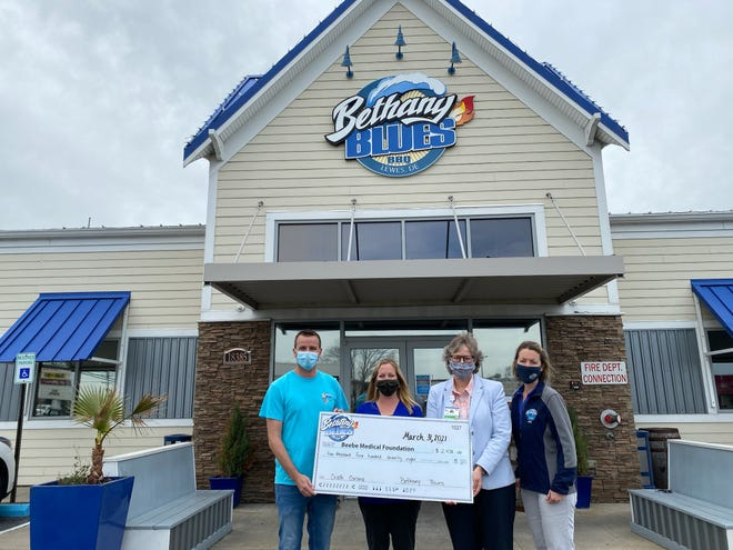 Bethany Blues of Lewes and Bethany Beach held a Dine & Donate event in March that raised $2,478 for Beebe Healthcare's COVID-19 Relief Fund. From left: Dave Grove, Bethany Blues general manager, Amy Popovich, Beebe Medical Foundation events coordinator, Kay Young, Beebe Medical Foundation executive director of development, Jessica Nathan, Bethany Blues director of operations.