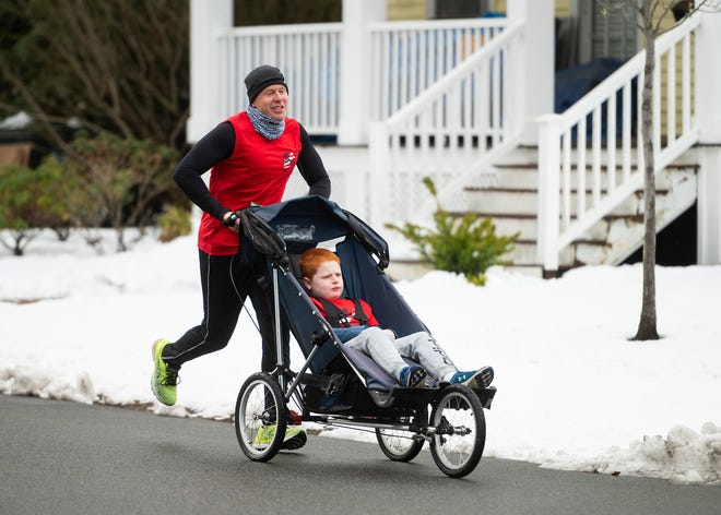 Ryan Murphy and son Jack will be running a mile (or more) on Patriots Day to honor Dick Hoyt, the Holland dad who became famous for pushing his son, Rick Hoyt, in a wheelchair in hundreds of road races, and died March 17.