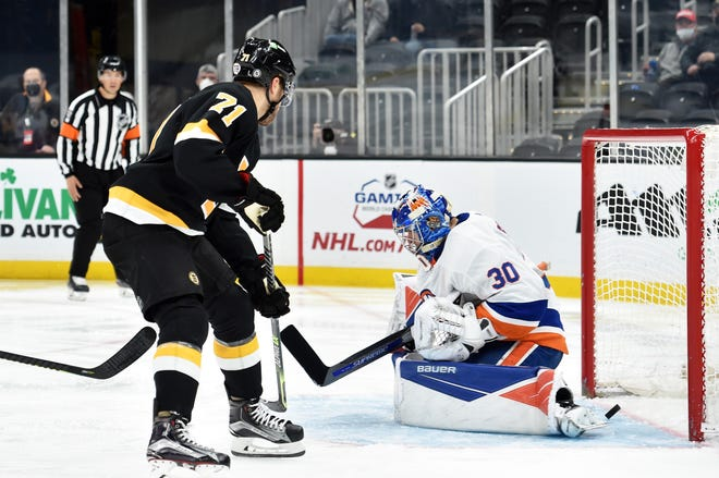 Bruins left wing Taylor Hall tips the puck past Islanders goaltender Ilya Sorokin for a goal during the second period Friday night at TD Garden.