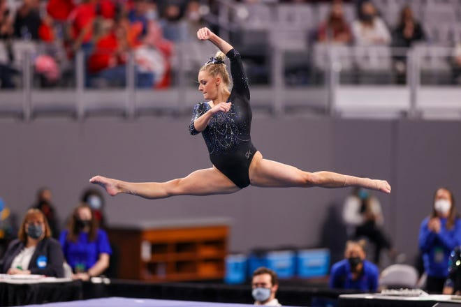 Florida's Alyssa Baumann performs on the floor during the finals Saturday of the NCAA Women's Gymnastics Championship at Dickies Arena in Fort Worth, Texas.