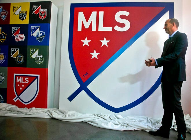 FILE - In this Sept. 18, 2014, file photo, Major League Soccer Commissioner Don Garber launches the league's new logo during a press conference  in New York. Garber said Tuesday, Dec 2, 2014, the league is not performing as hoped financially with the league and its franchises still losing more than $100 million combined annually.   (AP Photo/Bebeto Matthews)