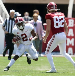 White team running back/wide receiver Keilan Robinson runs the ball on a punt return during the University of Alabama A-Day Game at in April. On Sunday, Robinson announced he was transferring to Texas.
