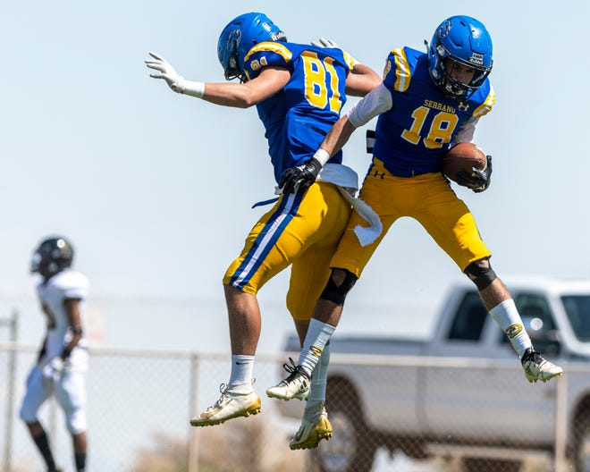 Serrano's Chris Eaton, right, celebrates with Mathew Gibes after scoring a touchdown against Hesperia on Saturday, April 17, 2021.