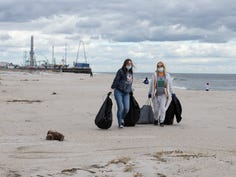 Clean Ocean Action Beach Sweeps takes place at over sixty locations along the coast. Volunteers pick up litter and document their findings which helps to identify pollution problems that effect our environment. Gabby Dziadyk and Rhonda Iannuzzelli, both volunteers from Timberland, Jackson, lug large amounts of garbage off the beach.         Seaside Park, NJ Saturday, April 17, 2021