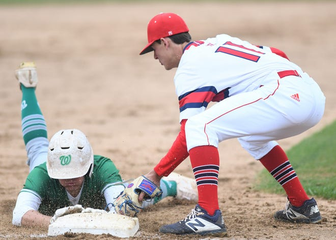 Jim Ned third baseman Blaine Palmer tags out Wall's Kye Herbert after Herbert tried to stretch his hit into a triple in a District 6-3A game Friday, April 16, 2021, in Tuscola.