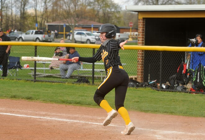 Colonel Crawford's Allison Weithman slaps a pitch and heads toward first base.