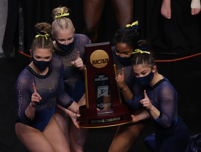 The Michigan women's gymnastics team celebrates after winning the national championship on Saturday, April 17, 2021, in Fort Worth, Texas.