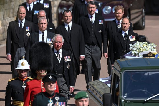 Britain's Prince Charles, left, Prince Andrew. Prince Edward, Prince William, Peter Phillips, Prince Harry, Earl of Snowdon and Tim Laurence follow the coffin the coffin makes it's way past the Round Tower during the funeral of Britain's Prince Philip inside Windsor Castle in Windsor, England, Saturday April 17, 2021.