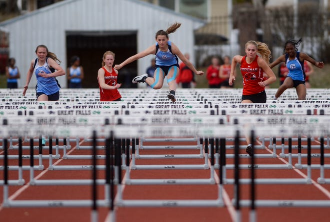 Great Falls High's Isabella Pachek, center, competes in the 100 meter hurdles at last week's Bison-Bozeman track meet at Memorial Stadium. Snow and cold weather forced cancellation of Friday's meet with Belgrade.