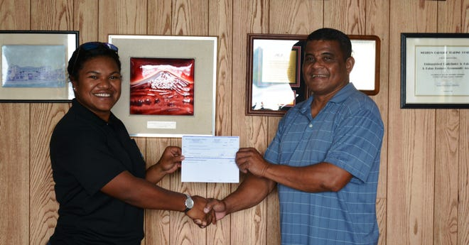 The Palau International Coral Reef Center (PICRC) is grateful to accept a donation of $1,500 from Western Caroline Trading Company (WCTC) for the 2022 Arts & Tides Calendar. PICRC would like to extend its sincerest gratitude to WCTC for their donation, and their continued support of the Center's mission for science and environmental education, particularly during the COVID-19 pandemic. Picture, from left, PICRC Policy Development Coordinator, Andrea Uchel and WCTC Personnel Manager, Mr. Russ Masayos.