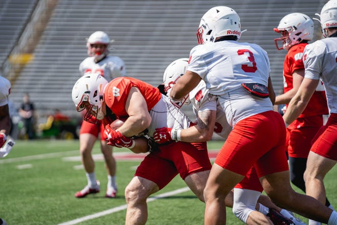 UW fullback John Chenal takes part in a spring practice on April 3.