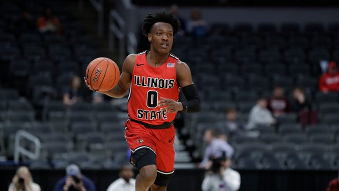 Illinois State's DJ Horne brings the ball down the court during the second half of an NCAA college basketball game against Drake in the first round of the Missouri Valley Conference men's tournament Thursday, March 5, 2020, in St. Louis.