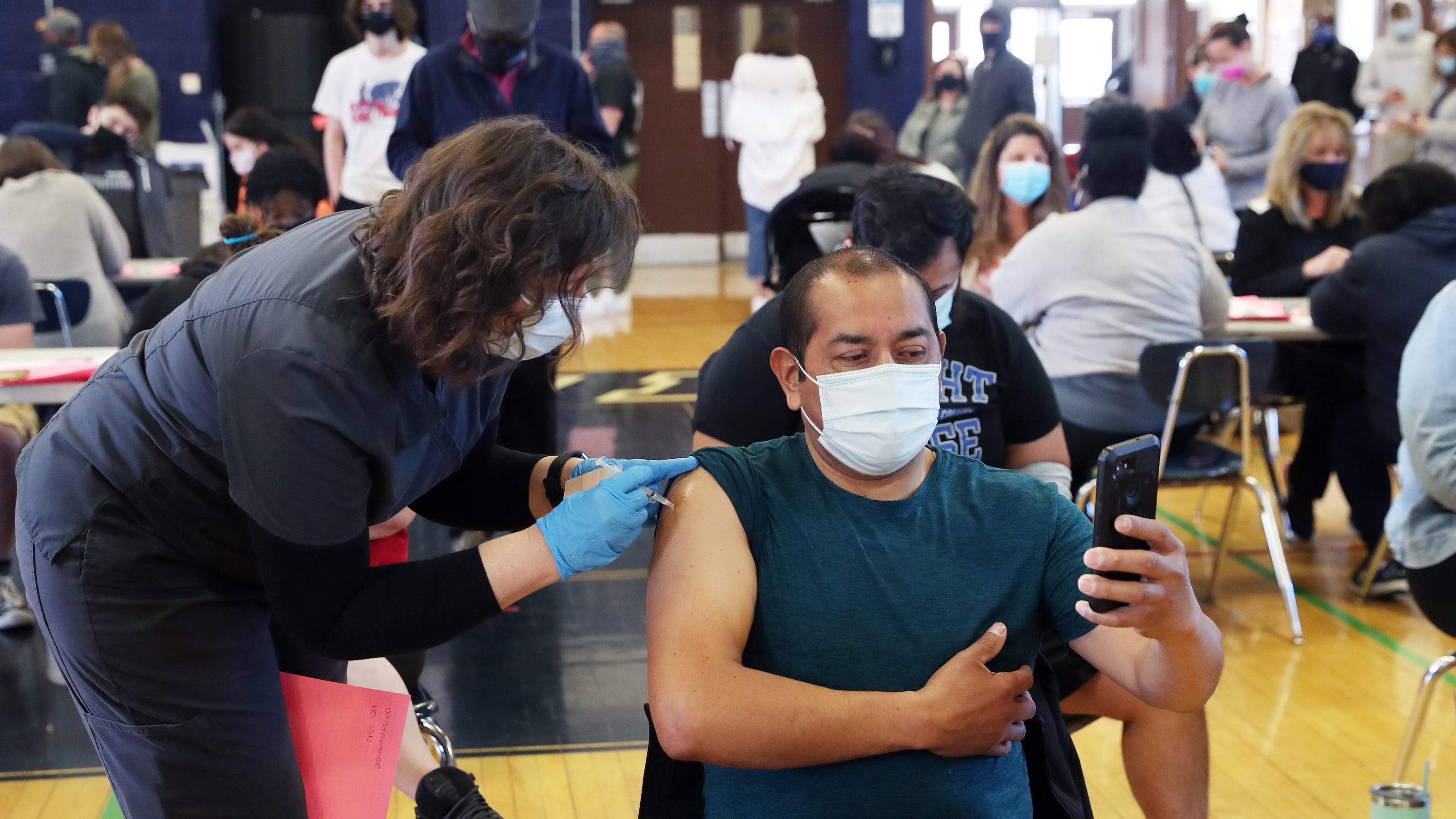 'We have to assume the best:' Despite hesitancy, hundreds vaccinated at Poughkeepsie High