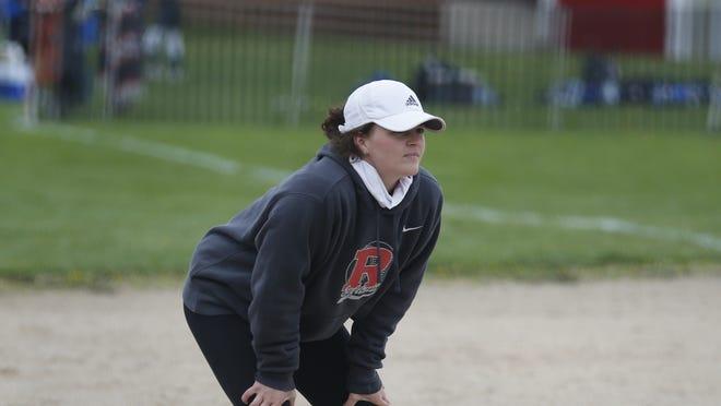 Richmond softball head coach Grace Townsend coaching third base against Hagerstown on Saturday, April 17, 2021.