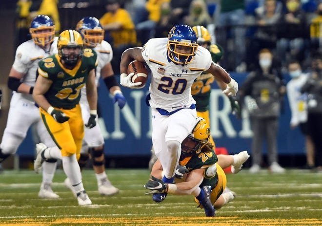 South Dakota State's Pierre Strong, Jr. slips out of the grasp of North Dakota State's James Kaczor during the Dakota Marker rivalry game on Saturday, April 17, 2021, at the Fargodome in Fargo.