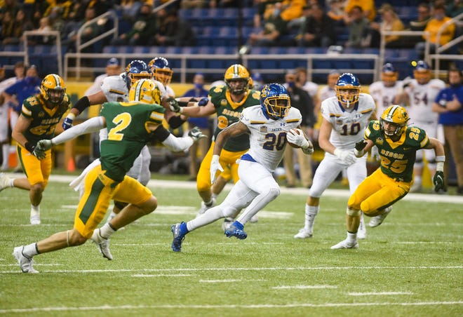 South Dakota State's Pierre Strong, Jr. runs up the field during the Dakota Marker rivalry game on Saturday, April 17, 2021, at the Fargodome in Fargo.