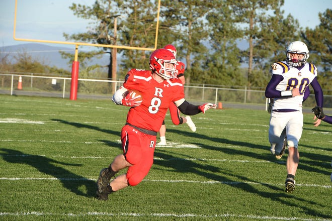 Riverheads' Zac Smiley looks to cut back to the middle of the field on the way to a touchdown Friday night. Riverheads beat Central Lunenburg 56-7 in the Region 1B championship.