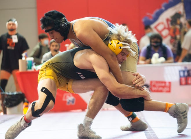 Amarillo High's Levy Slaydon (left) wrestles Fabens' Cris Del Rio in a 182-pound division match Friday during the Region I-5A wrestling tournament at Bel Air High School in El Paso.