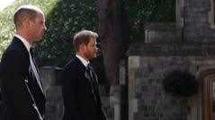 ALTERNATIVE CROP VERSION - Britain's Prince William, Duke of Cambridge (C) and Britain's Prince Harry, Duke of Sussex, (R) follow the coffin during the ceremonial funeral procession of Britain's Prince Philip, Duke of Edinburgh to St George's Chapel in Windsor Castle in Windsor, west of London, on April 17, 2021. - Philip, who was married to Queen Elizabeth II for 73 years, died on April 9 aged 99 just weeks after a month-long stay in hospital for treatment to a heart condition and an infection. (Photo by Alastair Grant / various sources / AFP) / ALTERNATIVE CROP VERSION (Photo by ALASTAIR GRANT/AFP via Getty Images)