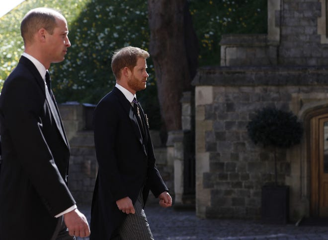 Prince William and Prince Harry follow the coffin during the ceremonial funeral procession of Prince Philip.