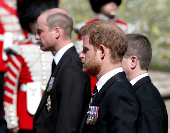 Prince William (left) and Prince Harry follow the coffin during the ceremonial funeral procession for their grandfather, Prince Philip.