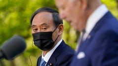 """Japanese Prime Minister Yoshihide Suga says he and President Joe Biden agree """"discrimination by race cannot be permitted."""""""