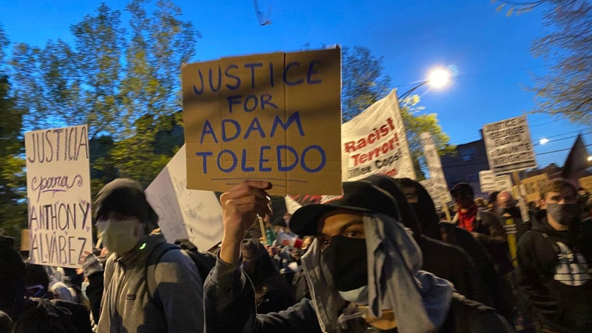 'We will not stop until there is justice': Over 1,000 in Chicago gather to remember Adam Toledo