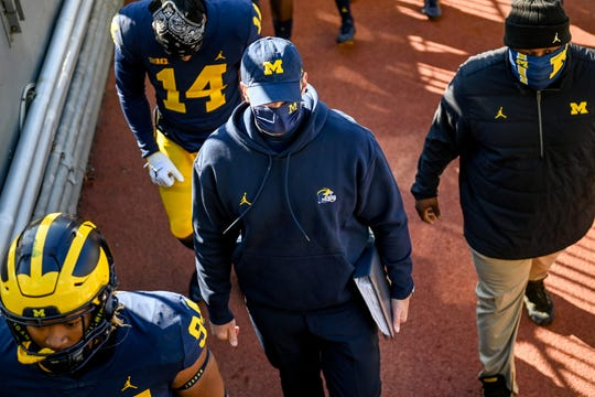 Michigan head coach Jim Harbaugh leaves the field after losing to Michigan State on Oct. 31, 2020.