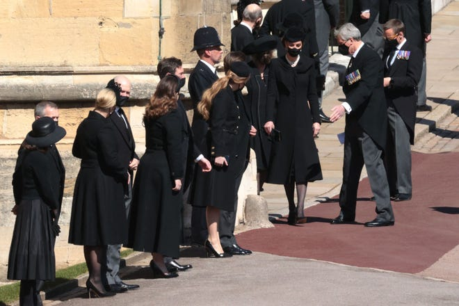 Catherine, Duchess of Cambridge, right, and members of the Royal family stand outside St George's Chapel for the funeral service of Britain's Prince Philip, Duke of Edinburgh in Windsor Castle in Windsor.