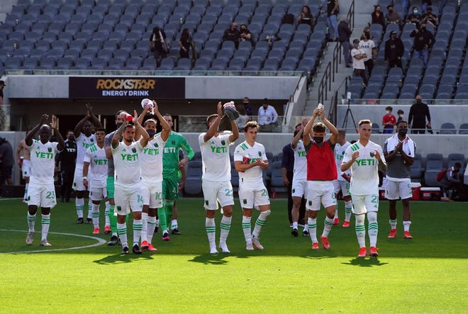 Austin FC players acknowledge supporters in attendance following the team's 2-0 loss to Los Angeles FC at Banc of California Stadium. A handful of fans traveled to L.A. for the team's first game in franchise history.