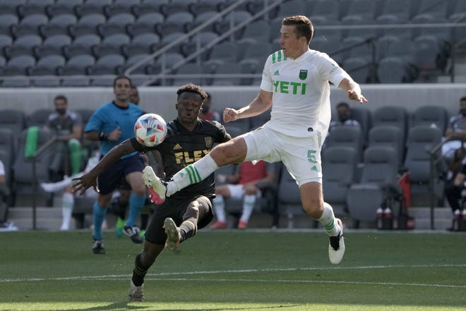 Austin FC defender Matt Besler, right, and LAFC forward Kwadwo Opoku battle for the ball during Austin FC's 2-0 loss at Banc of California Stadium in Los Angeles.