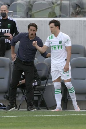 Austin FC coach Josh Wolff talks with midfielder Jared Stroud in the second half against LAFC at Banc of California Stadium on Saturday. Austin FC lost its debut while failing to score, but that won't deter fans who have waited years for Austin to gain a major professional sports team.