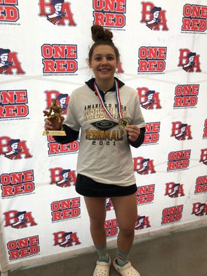 Amarillo High senior Faith Anderson poses with her Most Outstanding Wrestler award that she won at Saturday's Region 1-5A meet at Bel Air High School in El Paso.