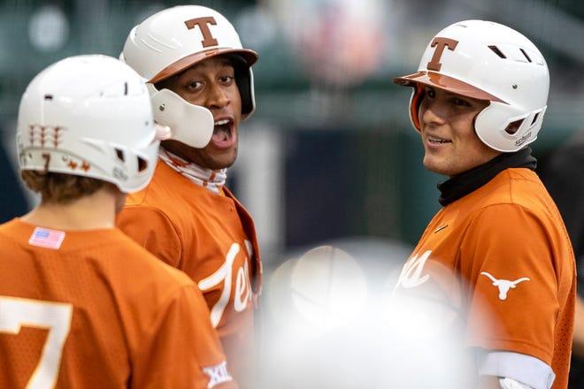Texas designated hitter Ivan Melendez (right) celebrates a two-run home run against Texas A&M-Corpus Christi with Cam Williams and Douglas Hodo III (7) in Austin earlier this month. Texas has won 13 straight games, following an 11-1 win over Abilene Christian on Sunday.