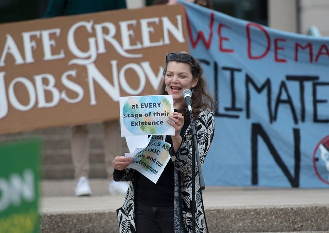 Environmental activist Dianne Peterson speaks during an Earth Day Rally at the Beaver County Courthouse Saturday afternoon in Beaver.