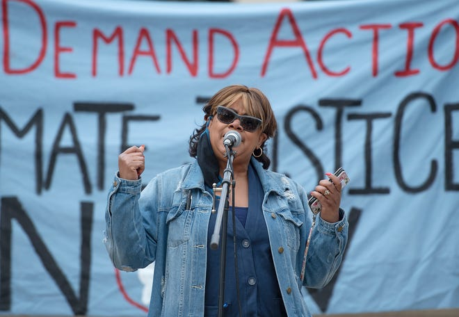 Lanita Desire of Aliquippa speaks about environmental justice during an Earth Day Rally at the Beaver County Courthouse Saturday afternoon in Beaver.