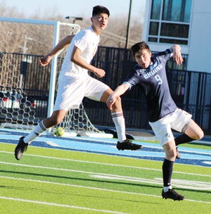 Brandon O'Rourke, right, has been a key performer this season for the Bartlesville High boys soccer team.