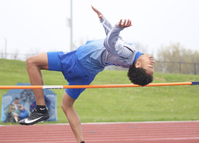 """Boonville senior Byron Thomas clears the bar in the high jump Friday during the Jack McCush Relays at the BHS Sports Complex. Thomas finished fourth in the high jump with a jump of 5'-5""""."""