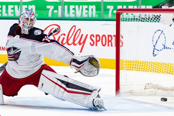 Joonas Korpisalo (70) was unable to stop this shot by Dallas Stars right wing Denis Gurianov during the second period of the Blue Jackets' 5-1 loss Saturday in Dallas. Korpisalo allowed four goals on 16 shots and was replaced in the second period by Elvis Merzlikins.
