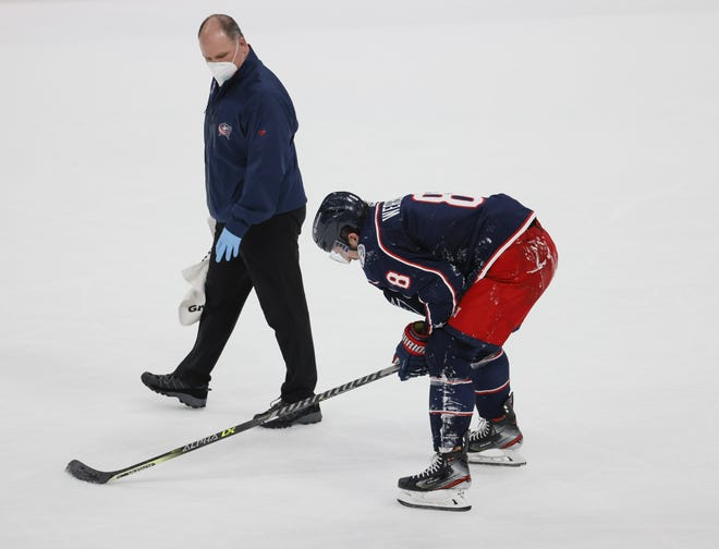 Blue Jackets defenseman Zach Werenski leaves the ice with an injury on March 25. Werenski played much of the season with a sports hernia that required surgery last week.
