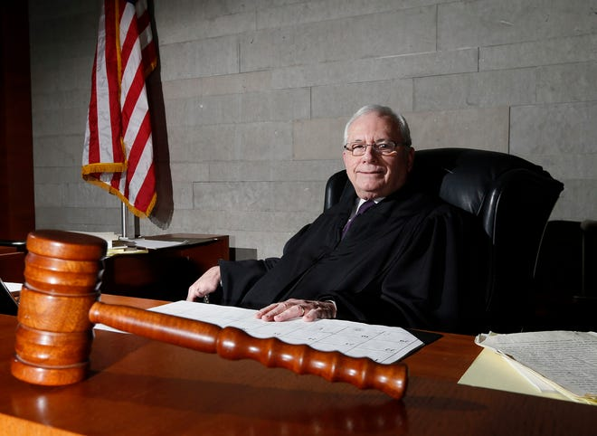 David W. Fais poses for a portrait in his courtroom in February 2015, the month he retired after 26 years as a Franklin County Common Pleas judge. (Columbus Dispatch photo by Brooke LaValley)