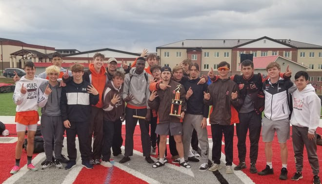 Meadowbrook's boys track team shows off some hardware on Saturday after taking first place in the Vic Thompson Invitational at Johnstown-Monroe High School.