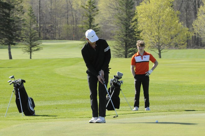 Hudson's Rhys Mitchell putts during the Madison Ryder Cup at Wolf Creek Golf Club.