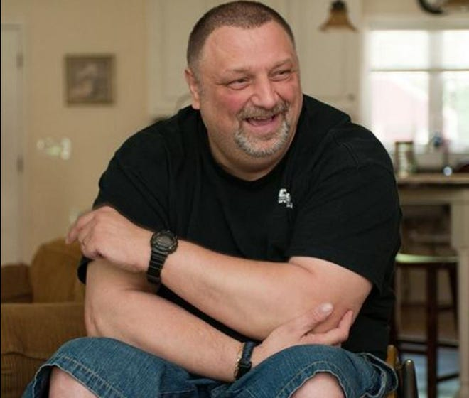 This file photo of former Lexington Police Officer David Parde shows him discussing the night he was shot and paralyzed while on duty in 1992. Parde always celebrated the anniversary date of the shooting with friends and family as a way to keep positive the tragic event that changed his life. This photo was taken for the 20th anniversary of the shooting.