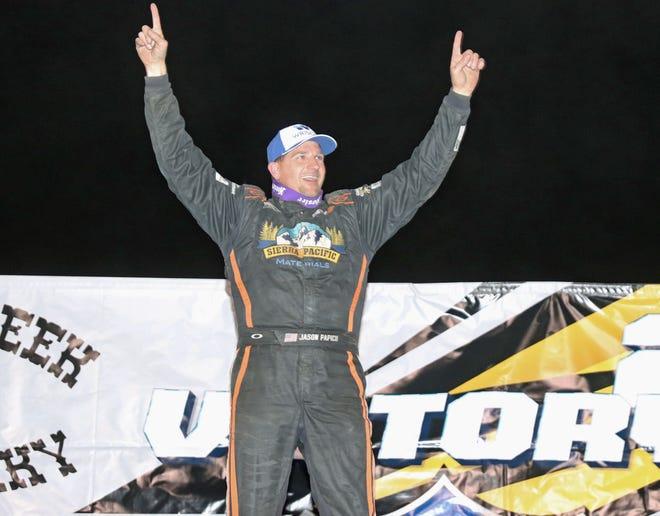 Jason Papich, California, celebrates his $10,555 Slocum 50 Lucas Oil MLRA late model feature win at 34 Raceway Saturday night.