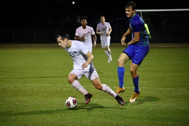 Ethan Dudley of Florida Gulf Coast (right) battles Jacksonville's Olivier Correa for the ball during the first half of Saturday's ASUN soccer championship at JU's Southern Oaks Stadium.