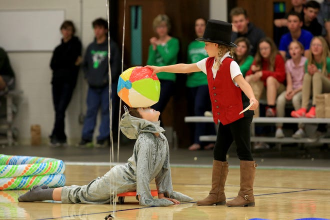 Seal performer Lane Lehman has a ball placed on his head by trainer Kree Miller during the annual Circus performance at Central Christian School Friday afternoon. To see a gallery of more circus photos, go to www.hutchnews.com