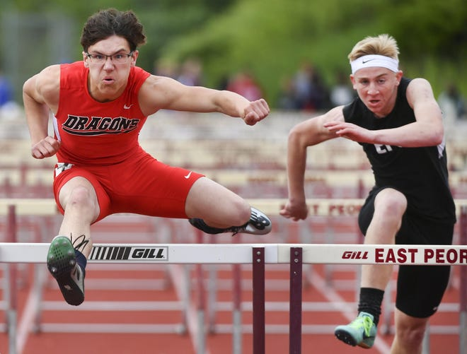 Logan Buck of Pekin, left, competes in the 2019 Journal Star Honor Roll Meet in East Peoria.