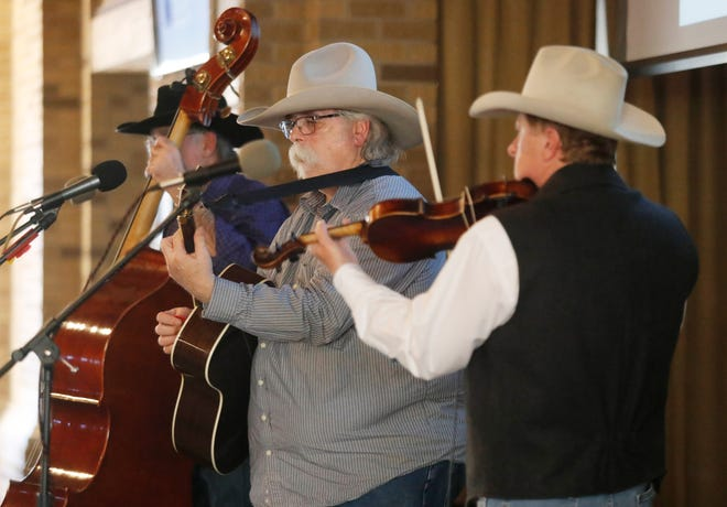 Members of the Lone Prairie Band, from left, Kurt Mello, Dave Branson and Mark Brown entertained the attendees. Boots and Buckles held their gala event benefiting Lubbock's Refuge services non-profit organization Saturday, April 18 at the Frazier Alumni Pavilion at Texas Tech.(Mark Rogers/Avalanche Journal)
