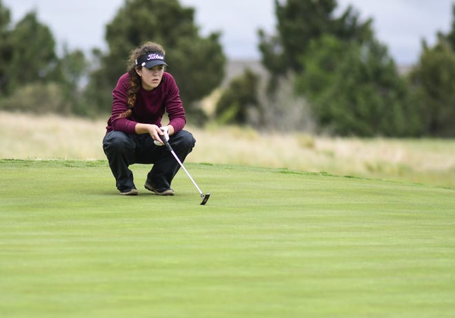 Lubbock High's Ella Booe lines up a putt on the No. 4 hole green during the Region I-5A girls golf tournament April 23, 2019 at the Rawls Golf Course.